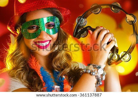 Beautiful woman dressed for carnival night - stock photo