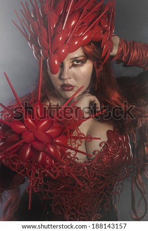 beautiful woman dressed in red armor dragon scales - stock photo