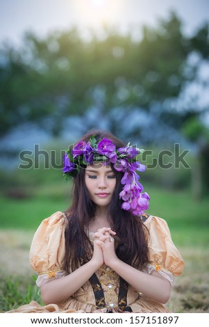 Beautiful woman dresses like princess - stock photo