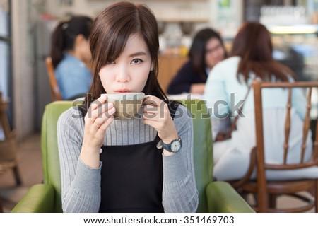 Beautiful Woman Drinking Coffee. - stock photo