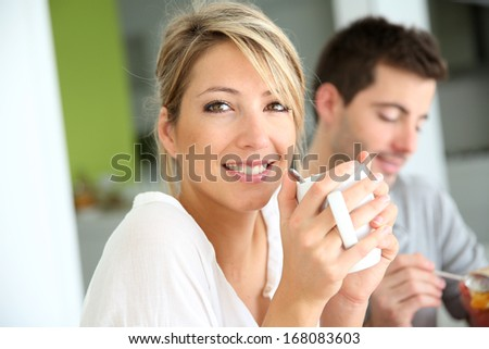 Beautiful woman drinking coffee at breakfast time - stock photo