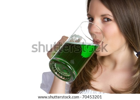 Beautiful woman drinking green beer - stock photo