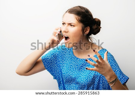 beautiful woman emotionally talking on a mobile phone - stock photo