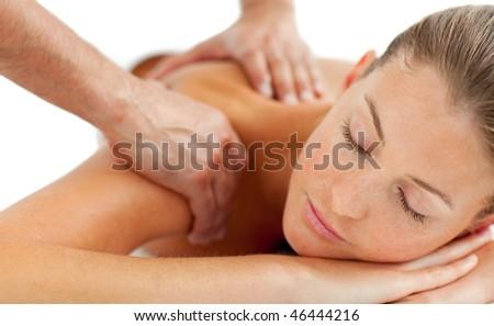Beautiful woman enjoying a massage in a spa center - stock photo