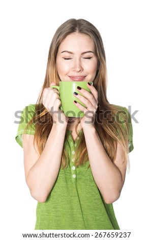 Beautiful woman enjoying cup of coffee isolated on white - stock photo