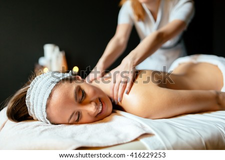 Beautiful woman enjoying massage and rejuvenating - stock photo