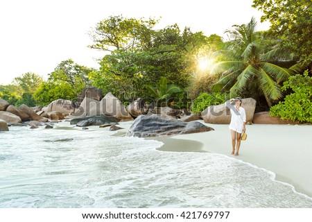 Beautiful woman enjoying the beautiful beachs of Praslin, Seychelles - stock photo