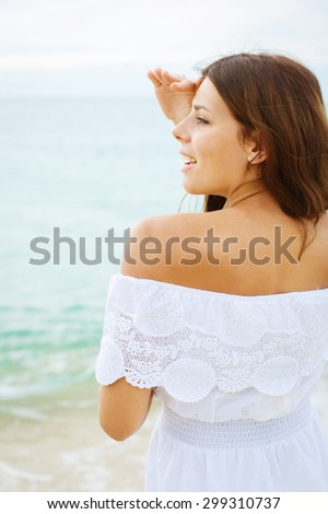Beautiful woman enjoying the summer sun in white dress. Glamorous girl with gold tattoo on the hand. - stock photo