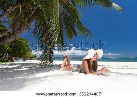 Beautiful woman enjoying the sun - stock photo