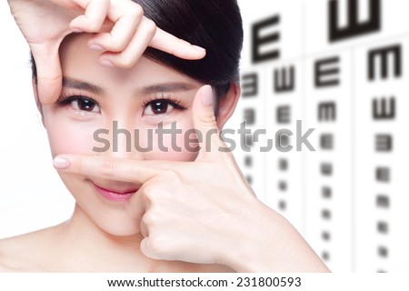beautiful woman eye close up with the background of eye test chart, eye care concept, asian beauty - stock photo