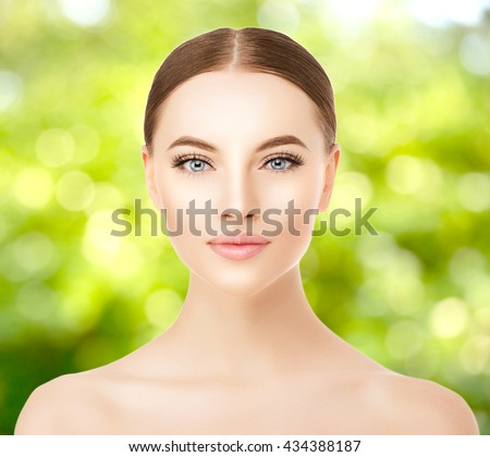Beautiful woman face close up studio. Beauty spa model female with clean fresh skin closeup, with perfect skin. Youth fresh skin care concept. Portrait of girl looking at camera, smiling. Cosmetology. - stock photo
