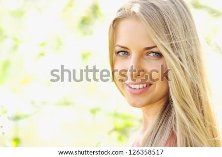Beautiful woman face - closeup - stock photo