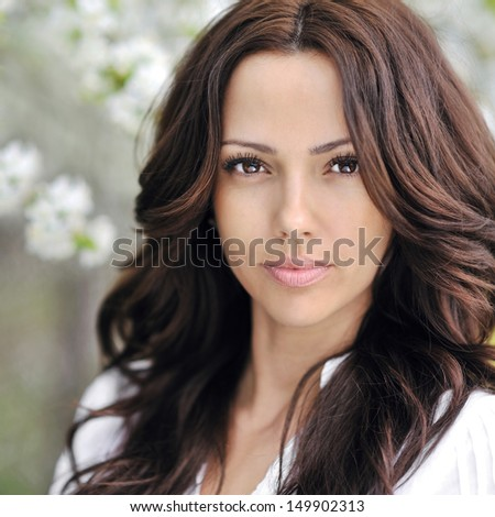 Beautiful woman face - outdoor portrait  - stock photo