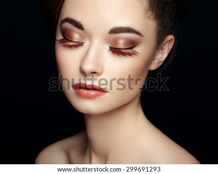 Beautiful woman face. Perfect makeup. Beauty fashion. Eyelashes. Cosmetic Eyeshadow. Elegant hairstyle - stock photo