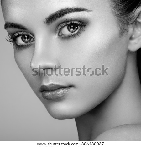 Beautiful woman face. Perfect makeup. Beauty fashion. Eyelashes. Cosmetic Eyeshadow. Highlighting. Black and white - stock photo