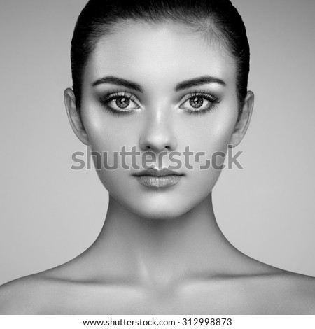 Beautiful woman face. Perfect makeup. Beauty fashion. Eyelashes. Cosmetic Eyeshadow. Highlighting. Black and white - stock photo