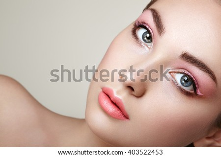Beautiful woman face. Perfect makeup. Beauty fashion. Eyelashes. Cosmetic Eyeshadow. Perfect skin - stock photo