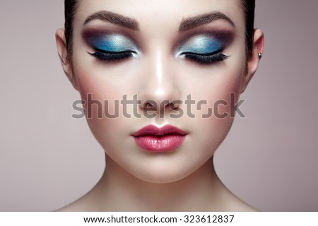 Beautiful woman face. Perfect makeup. Beauty fashion. Eyelashes. Lips. Cosmetic Eyeshadow - stock photo