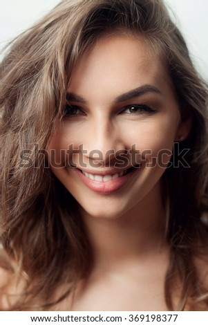 Beautiful woman face. Perfect toothy smile. Caucasian young girl close up portrait. red lips,  skin, teeth.  Studio shot . happy positive girl. - stock photo
