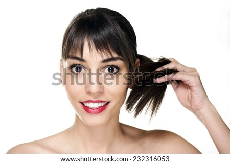 Beautiful woman face smiling,with white teeth and red lipstick playing with her hair, ponytail, isolated on white background - stock photo