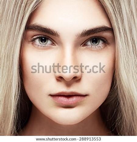 Beautiful woman face studio on white  - stock photo