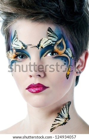beautiful woman face with Creative Fashion Art make up and eyelashes. - stock photo