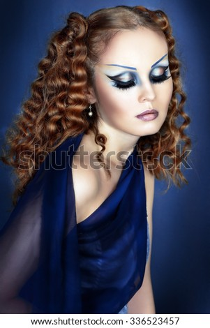 Beautiful woman face with Creative Fashion Art make up and eyelashes. Studio shot. Fansy hairstyle - stock photo