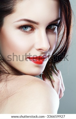 Beautiful woman face with red lips and chic glamour make-up close up - stock photo