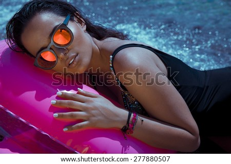 beautiful woman face with sunglasses. outdoors shot, horizontal  - stock photo