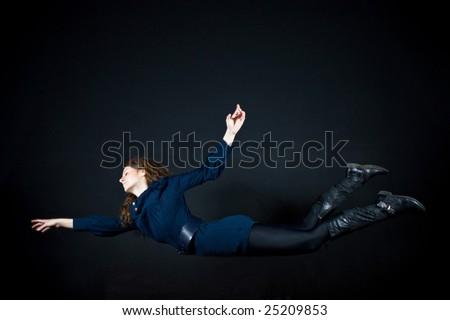 beautiful woman flying in studio - stock photo