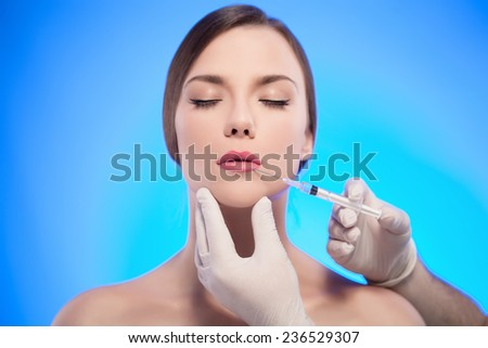 Beautiful woman gets injections. Cosmetology. Beauty Face - stock photo