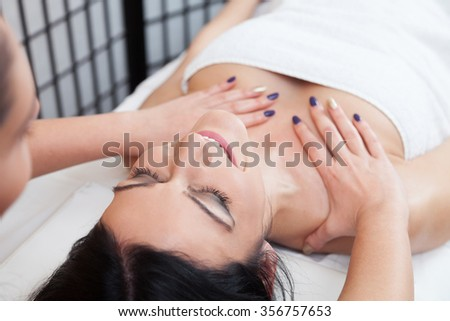 Beautiful woman getting a cleavage massage - stock photo