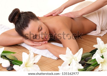beautiful woman getting a massage in the salon - stock photo