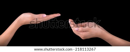 Beautiful woman hand holding isolated on black background - stock photo