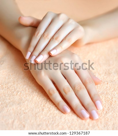 Beautiful woman hands are on a towel - stock photo