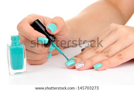 Beautiful woman hands with blue manicure,isolated on white - stock photo