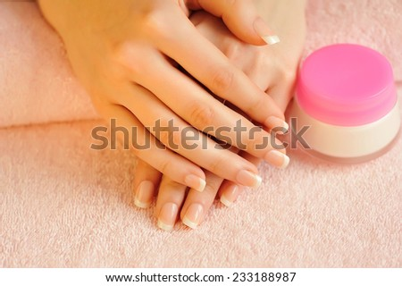 Beautiful woman hands with cream - stock photo