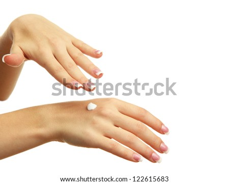 Beautiful woman hands with cream, isolated on white - stock photo