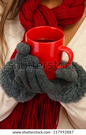 beautiful woman hands with cup of tea, close up - stock photo