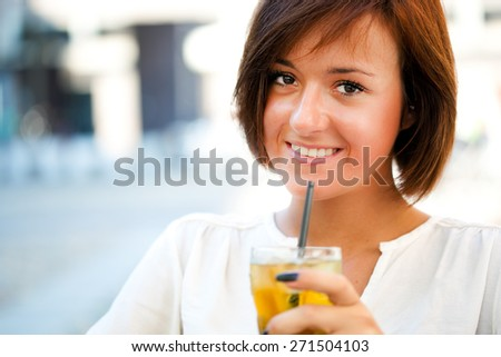 Beautiful woman having a drink - stock photo