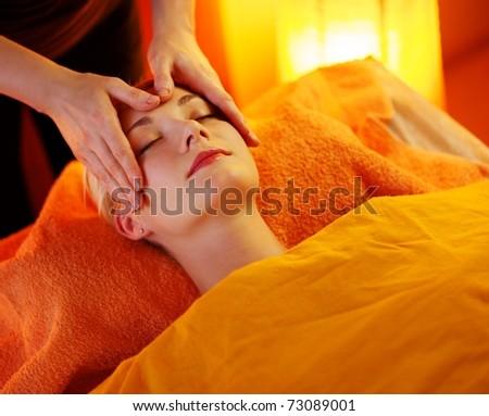 Beautiful woman having a face massage - stock photo