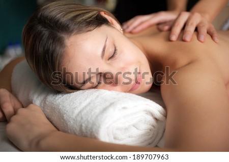 Beautiful woman having a massage - stock photo