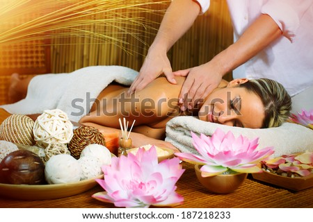 Beautiful woman having relaxing in spa massage salon. - stock photo