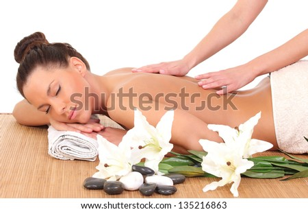 Beautiful woman having relaxing massage on her back in spa salon - stock photo