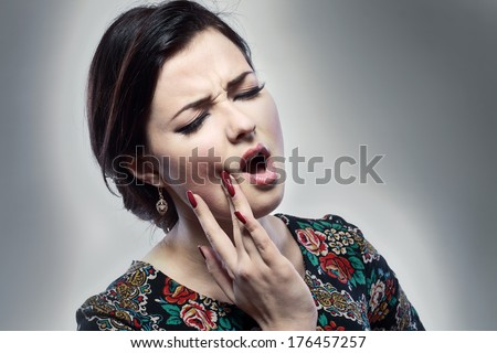 Beautiful woman having toothache close up - stock photo