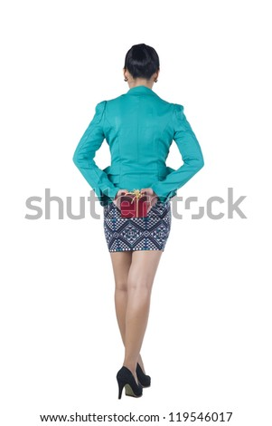 Beautiful woman hide behind back the present box, isolated on white background - stock photo