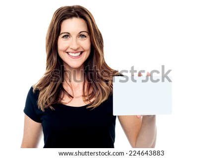 Beautiful woman holding a business card isolated on white - stock photo