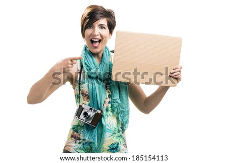 Beautiful woman holding a cardboard, isolated over a white background - stock photo