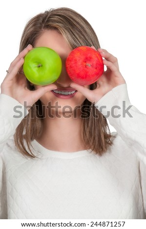 Beautiful woman holding a fresh and delicious green and red apple - stock photo