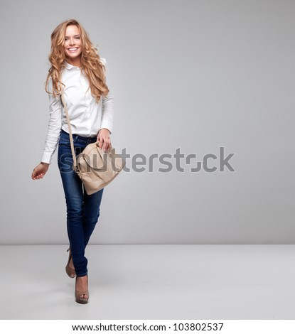 Beautiful woman holding a handbag - stock photo